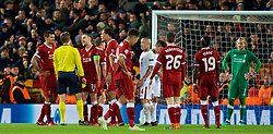 LIVERPOOL, ENGLAND - Tuesday, April 24, 2018: Liverpool's captain Jordan Henderson argues with referee Felix Brych after he awarded AS Roma a penalty during the UEFA Champions League Semi-Final 1st Leg match between Liverpool FC and AS Roma at Anfield. (Pic by David Rawcliffe/Propaganda)