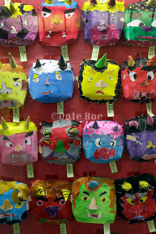 rows with by children made devil masks