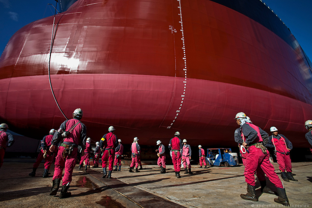 Workers go to the ship ATTALIA that was ordered by the Greek shipping company N.J.Goulandris Maritime Inc, to prepare it for its launching and naming ceremony.