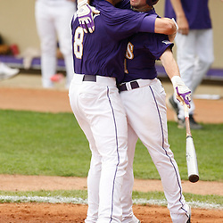 Apr 04, 2010; Baton Rouge, LA, USA; LSU Tigers out fielder Mikie Mahtook (8)celebrates with teammate Tyler Hanover (11) at homeplate following a solo homerun in the first inning against the Georgia Bulldogs at Alex Box Stadium. Mandatory Credit: Derick E. Hingle-US PRESSWIRE