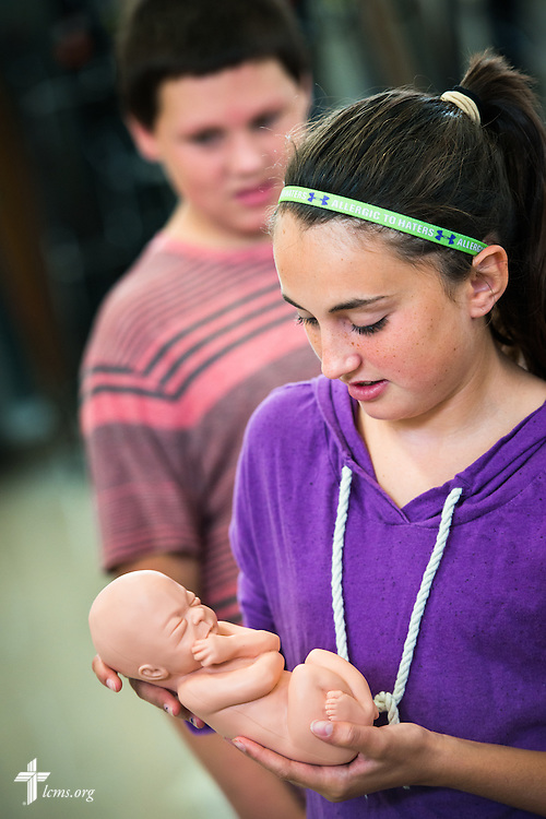 A student holds a fetal development model following an Owen's Mission presentation at Trinity Lutheran School on Monday, August 31, 2015, in Bloomington, Ill. LCMS Communications/Erik M. Lunsford