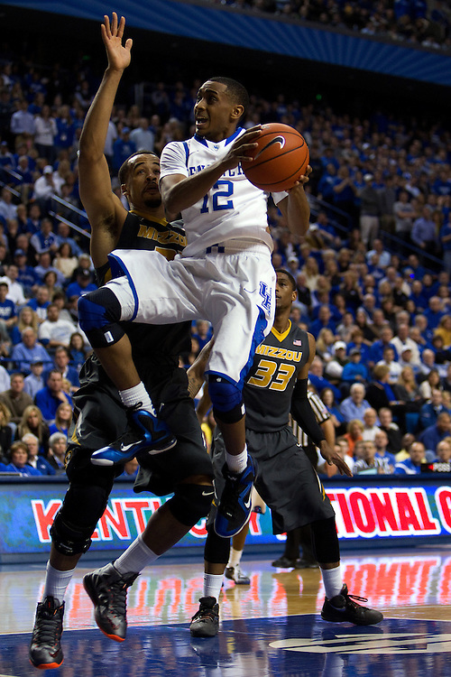 UK guard Ryan Harrow, right, drives to the basket in the first half. The University of Kentucky Men's Basketball team hosted Missouri , Saturday, Feb. 23, 2013 at Rupp Arena in Lexington .