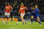 Brad Potts of Blackpool FC gets away from Liam Kelly of Oldham Athletic during the Sky Bet League 1 match between Oldham Athletic and Blackpool at SportsDirect.Com Park, Oldham, England on 15 March 2016. Photo by Mike Sheridan.
