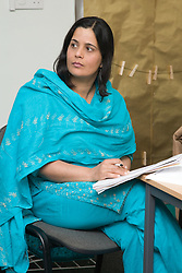 South Asian woman learning at adult education centre,