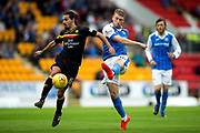 St Johnstone midfielder David Wotherspoon (#10) unleashes a shot beyond Partick Thistle midfielder Ryan Edwards (#19) during the Betfred Scottish Cup match between St Johnstone and Partick Thistle at McDiarmid Stadium, Perth, Scotland on 8 August 2017. Photo by Craig Doyle.