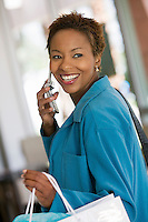 Woman on Cell Phone in furniture store