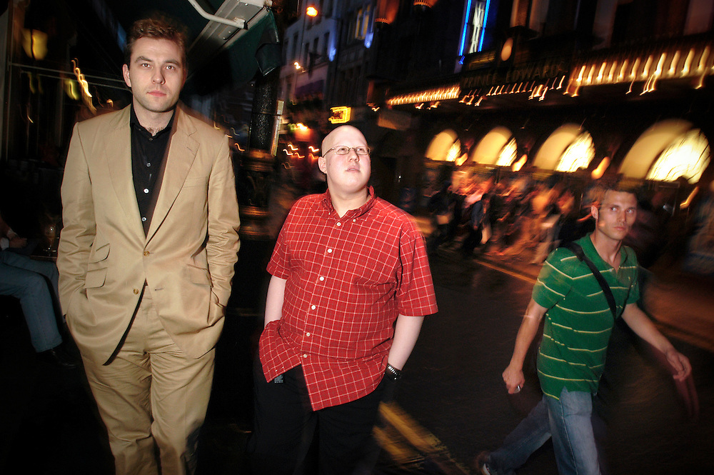UK. London. Little Britain stars, Matt Lucas (in red) and David Walliams on Old Compton Street in London's West End.