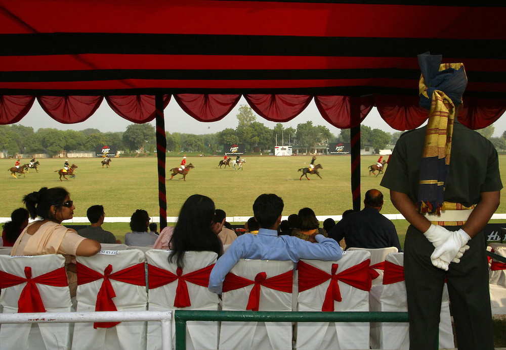 -It's polo season in India, and the well-bred man and horse alike are again facing off on grassy fields, endlessly mingling sport and spectacle at the Jaipur Polo Ground in New Delhi, India Sunday Nov. 3, 2002. There are galloping horses imported from Argentina and grooms in bright maroon turbans to care for them. There are wealthy players shouting in Hindi, Spanish and the most refined Oxford English. There are flocks of model-thin women in tight jeans and flashy jewelry.