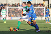 Lyle Taylor of AFC Wimbledon and Matt Dolan of Yeovil Town FC tussle during the Sky Bet League 2 match between AFC Wimbledon and Yeovil Town at the Cherry Red Records Stadium, Kingston, England on 30 January 2016. Photo by Stuart Butcher.