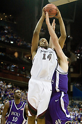 Southern Illinois Salukis forward Randal Falker (14) shoots over Holy Cross Crusaders center Tim Clifford (00).  The #4 seed Southern Illinois Salukis defeated the #13 seed Holy Cross Crusaders 61-51  in the first round of the Men's NCAA Tournament in Columbus, OH on March 16, 2007.