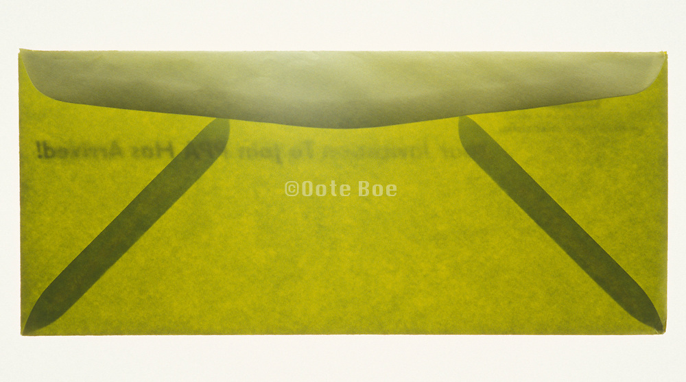 Still life of a green transparent envelope