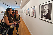 May 4, 2013 - Huntington, New York, U.S. - Visitors are looking at the 'belle arme' exhibit photographs by artist Lauren Weissler, at the Opening Reception at fotofoto Gallery, a cooperative photography gallery which is a non-profit organization.