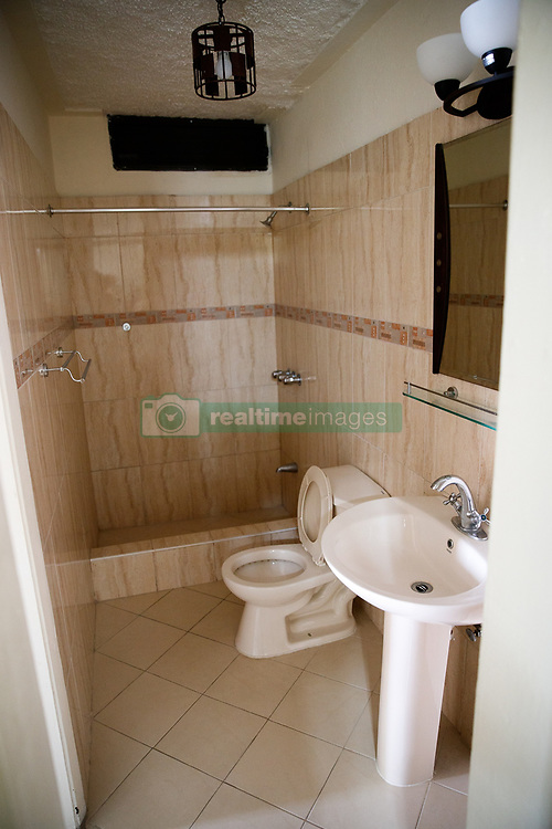 EXCLUSIVE: This is the luxury apartment complex in a run-down area of Port-au-Prince, Haiti, where a regional Oxfam director and aid workers are alleged to have exploited locals for sex after the 2010 earthquake in the poverty-stricken nation. 12 Feb 2018 Pictured: GV of the bathroom inside one of the apartments. Photo credit: MEGA TheMegaAgency.com +1 888 505 6342