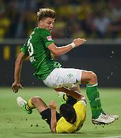 FUSSBALL   1. BUNDESLIGA   SAISON 2012/2013   1. SPIELTAG Borussia Dortmund - SV Werder Bremen                  24.08.2012      Sebastian Proedl (SV Werder Bremen) gegen Robert Lewandowski (am Boden, Borussia Dortmund)