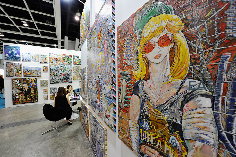 HONG KONG - MARCH 13:  Exhibitors sit in a booth on the preview day of Art Basel on March 13, 2015 in Hong Kong, Hong Kong.  (Photo by Lucas Schifres/Getty Images)