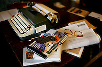 "Tools of a writer -- glasses, literary books, paper and a typewriter, at his home, in San Francisco, Ca., on Friday, February 6, 2008. Writer and poet August Kleinzahler, 60,  published his tenth collection of poetry, ""Sleeping it off in Rapid City"" last year."