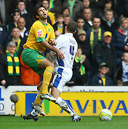 Norwich - Saturday March 27th, 2010:  Simon Lappin of Norwich is fouled by Michael Doyle of Leeds during the Coca Cola League One match at Carrow Road, Norwich. (Pic by Paul Chesterton/Focus Images)