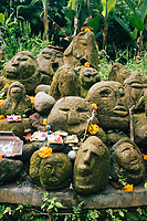Stone carvings near a small temple in Ubud, Bali, Indonesia.