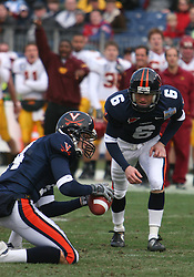 Virginia place kicker Connor Hughes (6) lines up for a field goal attempt.  The Virginia Cavaliers defeated the Minnesota Golden Gophers 34-31 at the Music City Bowl in Nashville, TN on December 30, 2005.