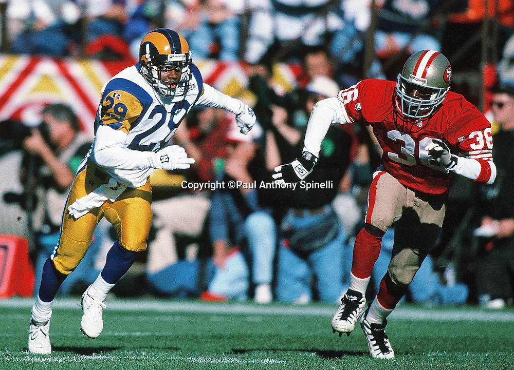 St. Louis Rams defensive back Dexter Davis (29) runs down field on special teams while being chased by San Francisco 49ers defensive back Merton Hanks (36) during the NFL football game against the San Francisco 49ers on Nov. 26, 1995 in San Francisco. The 49ers won the game 41-13. (©Paul Anthony Spinelli)