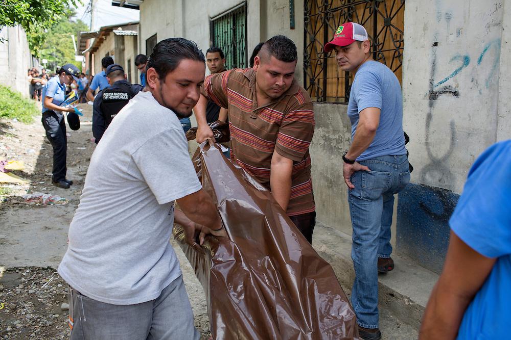 San Pedro Sula, Honduras<br /> <br /> Gerson Reyes 24, sk&ouml;ts ihj&auml;l p&aring; &ouml;ppengata. Hans dotter Yosselin 4 blev vittne till h&auml;ndelsen.<br /> <br /> Photo: Niclas Hammarstr&ouml;m