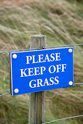 'Please Keep off the Grass' sign on mainland Orkney; Scotland,