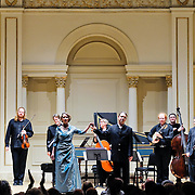 November 15, 2011 - Manhattan, NY : The Theatre of Early Music including, from left, Cynthia Roberts (violin), Edwin Huizinga (violin), Eric Milnes (harpsichord), Deborah York (soprano),  Amanda Keesmaat (cello), Daniel Taylor (conductor and countertenor), David Jacques (lute), Reuven Rothman (bass), and David Miller (viola), take a bow after performing works by George Frideric Handel in the Joan and Sanford I. Weill Recital Hall at Carnegie Hall on Tuesday night. CREDIT: Karsten Moran for The New York Times