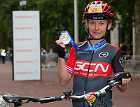 Emma Pooley with her finishers medal on The Mall. The Prudential RideLondon Sportives. Sunday 29th July 2018<br /> <br /> Photo: Andrew Baker for Prudential RideLondon<br /> <br /> Prudential RideLondon is the world's greatest festival of cycling, involving 100,000+ cyclists - from Olympic champions to a free family fun ride - riding in events over closed roads in London and Surrey over the weekend of 28th and 29th July 2018<br /> <br /> See www.PrudentialRideLondon.co.uk for more.<br /> <br /> For further information: media@londonmarathonevents.co.uk