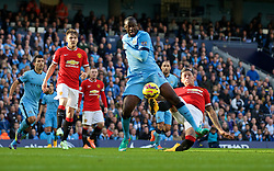 MANCHESTER, ENGLAND - Sunday, November 2, 2014: Manchester City's Yaya Toure is brought down in the penalty area by Manchester United's Marcos Rojo during the Premier League match at the City of Manchester Stadium. (Pic by David Rawcliffe/Propaganda)