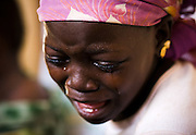 Assana Mohammed, 10, cries as a health worker extracts a guinea worm her ankle at the guinea worm case containment center in Savelugu, northern Ghana, on Friday March 9, 2007. A parasite transmitted through water, guinea worm emerges from the host's body nine months after drinking contaminated water. Measuring up to 1 meter, it can only be pulled out a few cm every day to prevent it from breaking inside the host's body. Despite a widespread eradication program Ghana has the second largest number of cases in the world - after Sudan..