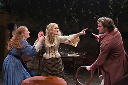 """© Licensed to London News Pictures. 21/11/2013. London, England. L-R: Emma West as Lizzie Siddal, Jayne Wisener as Annie Miller and Tom Bateman as Dante Gabriel Rossetti. World premiere of the play """"Lizzie Siddal"""" at the Arcola Theatre, Hackney, London. The play tells the story of the woman who was 'Ophelia' in Millais' famous painting. Running from 20 November to 21 December 2013. With Emma West as Lizzie Siddal and Tom Bateman as Dante Gabriel Rossetti. Photo credit: Bettina Strenske/LNP"""