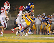 Oxford High's D.K. Metcalf (14) vs. Jackson Prep's Zach Williams (26) in Oxford, Miss. on Friday, August 23, 2013. Oxford won 32-20.
