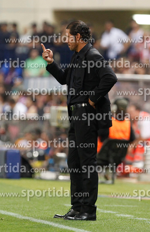 21.08.2013, Estadio Vicente Calderon, Madrid, ESP, Supercup, Atletico Madrid vs FC Barcelona, im Bild Atletico de Madrid's coach Cholo Simeone // during the Spanish Supercup match between Club Atletico de Madrid and Barcelona FC at the Estadio Vicente Calderon, Madrid, Spain on 2013/08/21. EXPA Pictures &copy; 2013, PhotoCredit: EXPA/ Alterphotos/ Ricky Blanco<br /> <br /> ***** ATTENTION - OUT OF ESP and SUI *****