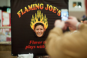 Phuong Tien has her photo made at the Flaming Joe's booth during ZestFest at the Irving Convention Center on Saturday, January 26, 2013 in Irving, Texas. (Cooper Neill/The Dallas Morning News)
