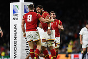 Wales scrum half Gareth Davies is congratulated after his try by Wales back row Taulupe Faletau during the Rugby World Cup Pool A match between England and Wales at Twickenham, Richmond, United Kingdom on 26 September 2015. Photo by David Charbit.