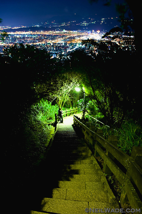 Night time hiking trail, Taipei, Taiwan.  One of the greatest things about living in Taipei is all the quick and easy city escapes. This picture was taken on a trail that starts about two km away from Taipei 101. You can hike it 24 hours a day and are rewarded with beautiful views of the city set among the seclusion of a tropical jungle.