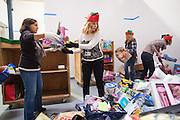 Malti Bhatt-Dudakia, left, and Dinese Lombard of Cisco Systems, Inc., Global Procurement Services department sorts donated toys at The Family Giving Tree in Milpitas, California, on December 18, 2014. (Stan Olszewski/SOSKIphoto)