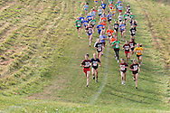 Warwick, N.Y. - Runners head down a hill during a girls' race at the New York State Public High School Athletic Association cross country championships at Sanfordville Elementary School on Nov. 11, 2006.<br />