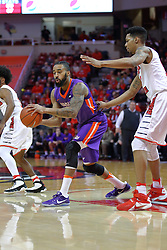 29 December 2016: Soloman Hainna passes off when approached by Phil Fayne(10) during an NCAA  MVC (Missouri Valley conference) mens basketball game between the Evansville Purple Aces the Illinois State Redbirds in  Redbird Arena, Normal IL