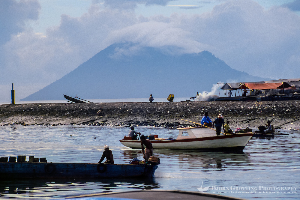 Indonesia, Sulawesi, Manado. Manado harbour with Manado Tua, an extinct volcano, in the background.