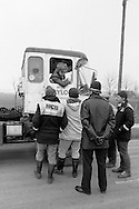 Pickets talking to a lorry driver during the 1984 miners strike, Grimethorpe. March 1984