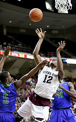Texas A&M's Jalen Jones (12) takes a shot off balance against Florida Gulf Coast University's Zach Johnson (5) during a NCAA college basketball game in College Station, Texas, Wednesday, Dec. 2, 2015.  (AP Photo/Sam Craft)