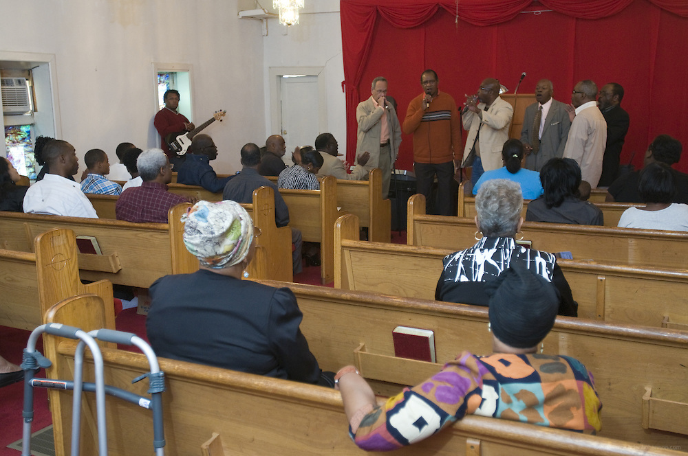 "The Chosen Few, an all-male gospel quartet, fill the chapel with ""Lord Show Me The Way,"" during a joining ceremony at the First Church of American Slaves, Saturday, Sept. 17, 2011 in Louisville, Ky. (Photo by Brian Bohannon)"