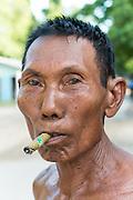 Myanmar, portrait or man smoking a local cigar called a cheroot (Burma)