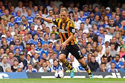 Hull City's David Meyler takes a shot at goal  - Photo mandatory by-line: Mitchell Gunn/JMP - Tel: Mobile: 07966 386802 18/08/2013 - SPORT - FOOTBALL - Stamford Bridge - London -  Chelsea v Hull City - Barclays Premier League