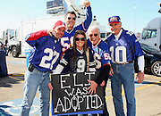 IRVING, TX - JANUARY 13: Giants and Cowboys fans have some fun with an Eli Was Adopted sign referring to quarterback Eli Manning #10 of the New York Giants as they get fired up while tailgating for the NFC Divisional Playoff Game between the New York Giants and the Dallas Cowboys at Texas Stadium on January 13, 2008 in Irving, Texas. ©Paul Anthony Spinelli