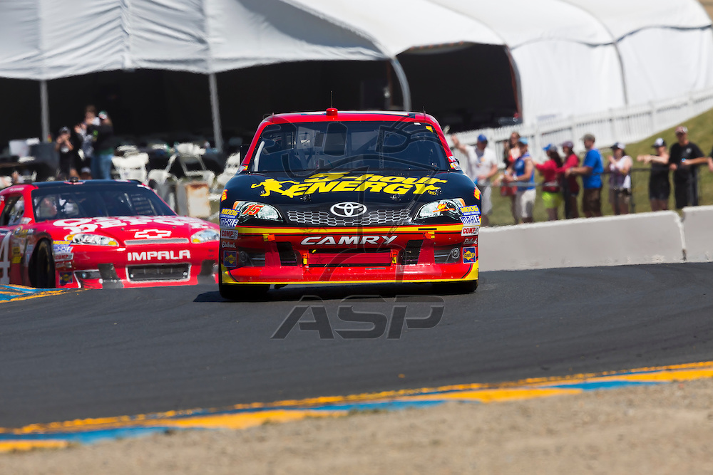 SONOMA, CA - JUN 24, 2012:  Clint Bowyer (15) holds off a hard charging field to win the Toyota Save Mart 350 at the Raceway at Sonoma in Sonoma, CA.