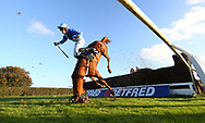 Plumpton, UK. 17th October 2016. Tom Bellamy parts company with Berry De Carjac at the open ditch during the Winner Event Services Novices&acute; Handicap Chase .<br /> &copy; Telephoto Images / Alamy Live News