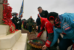 11 November 2018. Lochnagar Crater, La Boisselle, Somme, France. <br /> <br /> The Mayor of La Bissell, Christian Bernard lays a wreath at the memorial service. Gathered in the pouring rain, those who perished in the Great War are remembered by British and French civilians on the 100th anniversary of the Great War. <br /> <br /> Lochnagar Crater was created by the Tunnelling Companies of the Royal Engineers under a German field fortification. The explosion was the loudest man made noise created at that time, purportedly heard in London. <br /> <br /> Photo©; Charlie Varley/varleypix.com