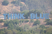 LOS ANGELES - MAY 03:  The Think Blue sign appears on the hillside past center field prior to the Los Angeles Dodgers game against the San Diego Padres at Dodger Stadium on Sunday, May 3, 2009 in Los Angeles, California.  The Dodgers won their 10th straight home game while defeating the Padres 7-3.  (Photo by Paul Spinelli/MLB Photos)